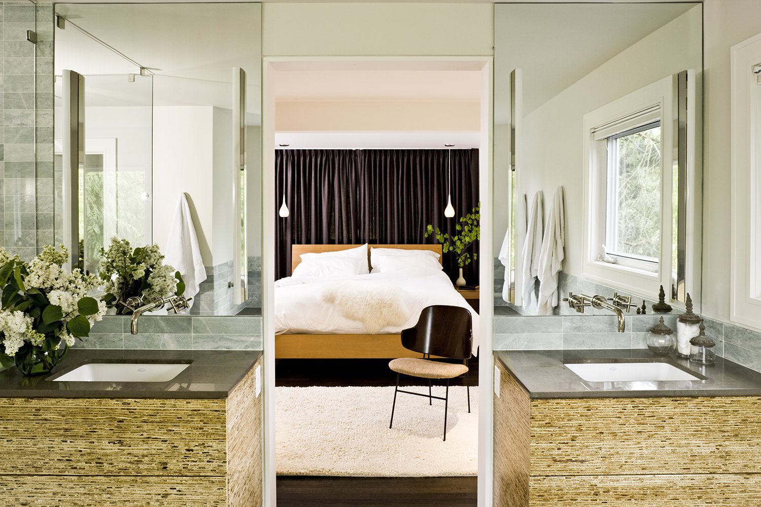 Bath Room, Undermount Sink, Dark Hardwood Floor, and Pendant Lighting The cabinets in the master bathroom are made of kirei board, a material produced from the stalks of sorghum.  Photo 4 of 5 in A Designer's Tips For Renovating a Midcentury Modern Interior