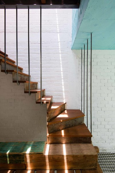 Reclaimed wood, weathered steel risers, wood treads, and steel rebar supports work together to create this unique staircase designed by Saigon-based architect Toan Nghiem of a21 Studio. Despite the stair's modern silhouette and use of steel, the materials collectively create a warm, inviting palette.