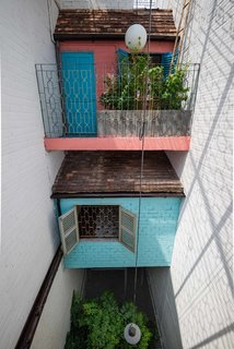 A Narrow Courtyard Joins a Unique Two-Family Home in Saigon - Photo 9 of 10 -