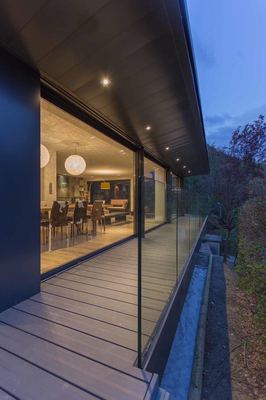 Outdoor, Small Patio, Porch, Deck, and Wood Patio, Porch, Deck The interior is furnished with contemporary pieces that don't detract from views of the surrounding valley.  Photo 4 of 8 in A Mountain Hideaway Plants a Green Roof in the French Alps