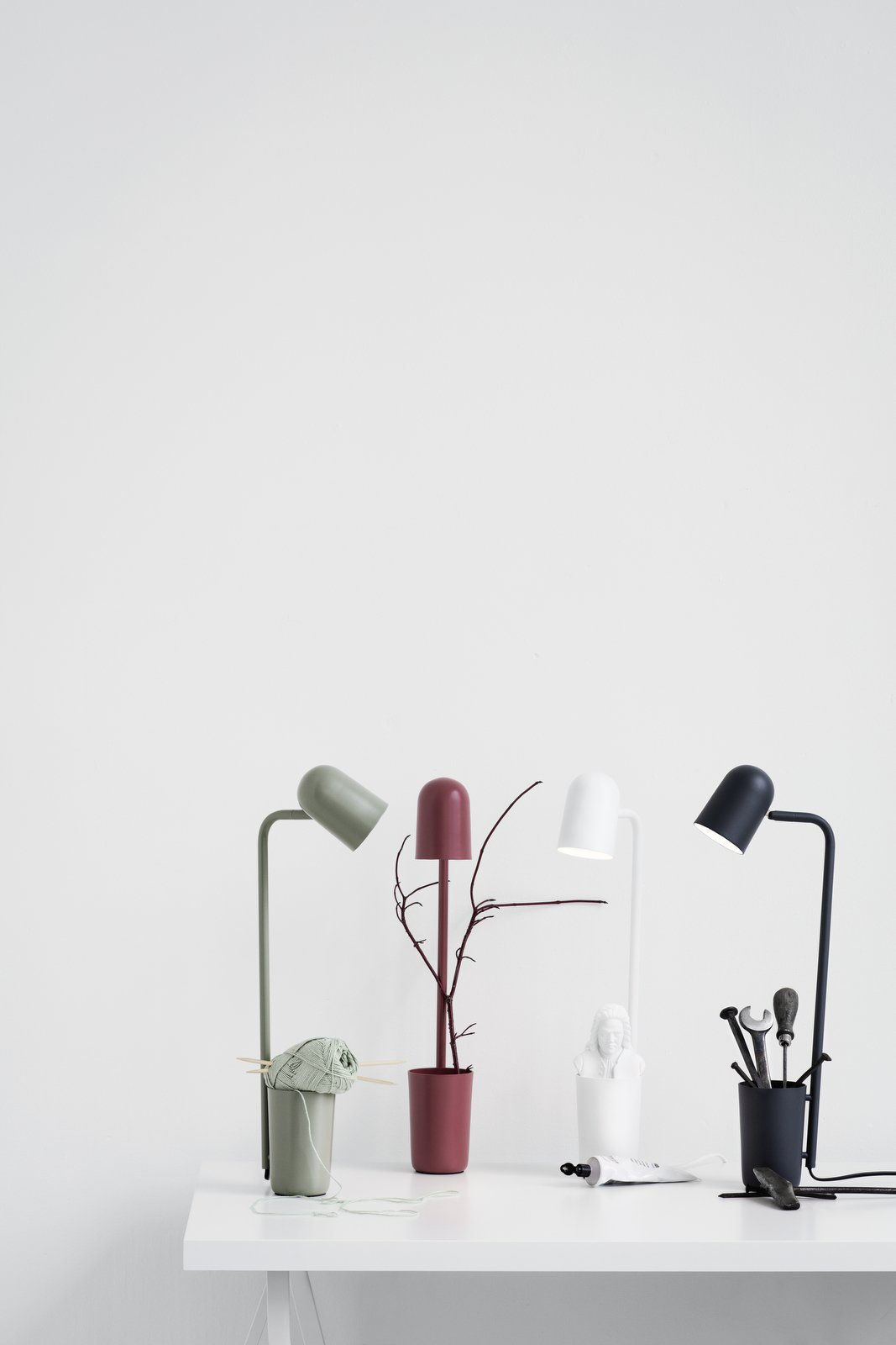 An unassuming little helper is how young Danish designer Mads Sætter-Lassen modestly describes his desk lamp, Buddy, designed for Northern Lighting. The multifunctional design includes a holder to keep pens, keys, and other small objects that are easily lost. The flexible shade, available in five matte colors, can be rotated in any direction.  Photo 9 of 10 in 10 First Steps to Follow When Planning the Perfect Lighting For Your Home from New Nordic Designs to Love from Stockholm Design Week 2016