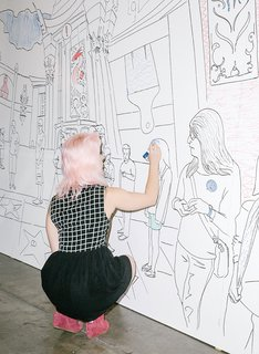 A visitor works on IdeaPaint's dry-erase coloring wall.
