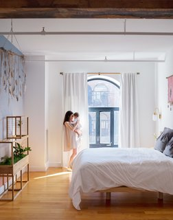 Aurora Ray, a color-gradient wallpaper inspired by the sunset as seen from Red Hook, accents the master bedroom, furnished with a custom bed frame by VIDIVIXI. The couple also designed a collection named after their daughter, Willow, exploring the movement of water and trees.
