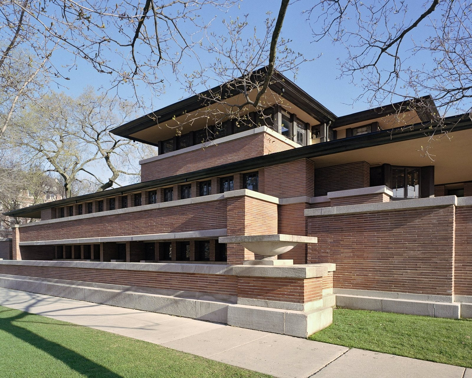 Exterior, Brick Siding Material, and House Building Type The Frederick C. Robie house, south elevation, Chicago, Illinois, by Frank Lloyd Wright.  Photo 8 of 10 in 10 Frank Lloyd Wright Buildings We Love from The Getty Foundation's Modern Architecture Conservation Initiative