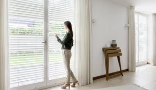 According to the U.S. Consumer Product Safety Commission, dangling cords from blinds are one of the top dangers for babies and toddlers. To remove the risk of cord-related accidents, invest in cordless blinds, such as these from Hunter Douglas. Thanks to PowerView Motorization technology, you can control light penetration with a smart, battery-operated wand control system, and can keep your nursery well shaded in the heat of the day.