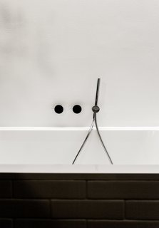 We Can't Get Enough of This German Apartment's Sleek Matte-Black Kitchen - Photo 8 of 11 - Fixtures by Naoto Fukasawa for Aboutwater, a collaboration between Boffi and Fantini, adorn the Villeroy & Boch tub.