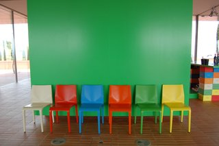 The bright-green hue of this wall, seen just inside the entrance, was used as a complementary color throughout the property.