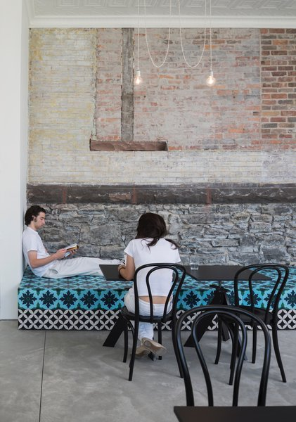 A Historic Masonry Stove Becomes the Hidden Gem of a New Cafe - Photo 1 of 8 -