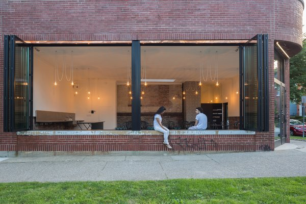 A Historic Masonry Stove Becomes the Hidden Gem of a New Cafe - Photo 3 of 8 -