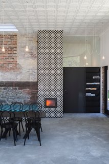 A Historic Masonry Stove Becomes the Hidden Gem of a New Cafe - Photo 6 of 8 -