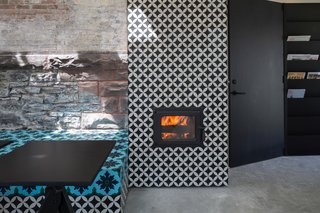 A Historic Masonry Stove Becomes the Hidden Gem of a New Cafe