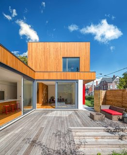 In addition to a shared courtyard, each family member has a private terrace. The rental unit has its own outdoor space too, in the form of a front yard protected by a hedge.