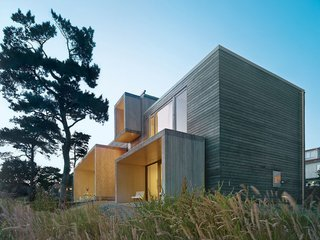 Fjallbacka House Wingårdh designed this vacation home for two midcentury furniture dealers on the western coast of Sweden. The three-bedroom house is comprised of several pine-clad boxes connected together. The house features a roof deck to enjoy the views of the sea.