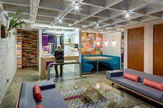 The raw concrete shell is accented everywhere by vivid patterns. Certain columns are dressed in wooden floorboards that were upcycled from an old building in the Colonia Condesa, then painted a patchwork of different colors.