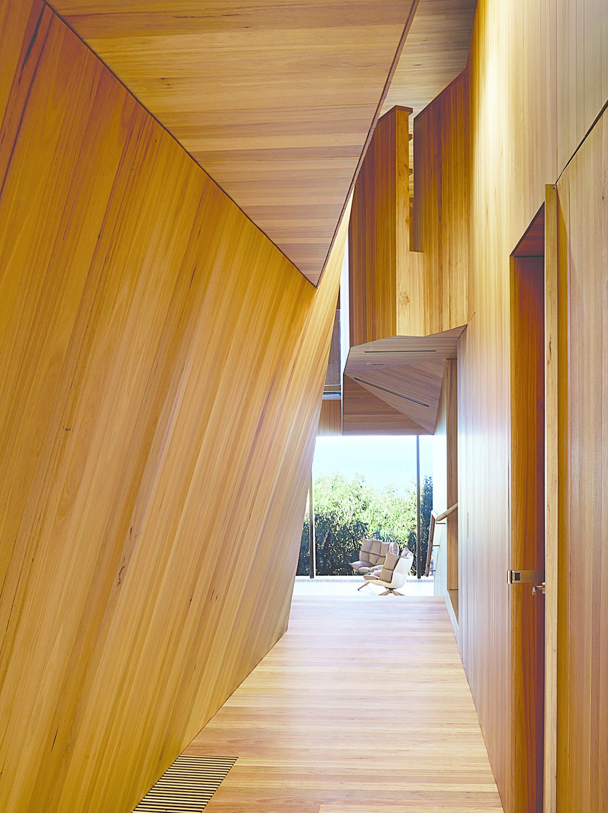 The house that architect John Wardle designed for a couple in coastal Fairhaven, Australia, twists and bends to comply with local laws that prevent buildings from disrupting the ridgeline views from the Great Ocean Road.  Photo 3 of 10 in This Surfer Rules the Ocean from a Cliffside House