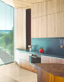 """Wardle's firm designed the end-grain butcher's block (left), which serves as an end-of-day gathering point where their kitchen meets the dining area. """"We were happy to let John go free and see what he came up with,"""" the wife says. """"He thought of things we would never have thought of, like the chopping board. He knew what we wanted."""""""