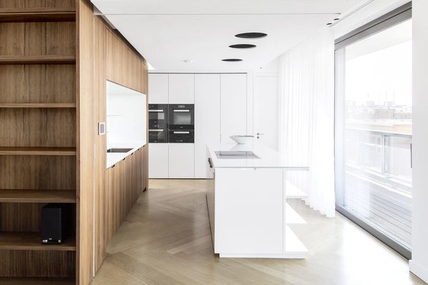 The kitchen, with a custom island by the architects, has a Blanco sink and Dornbracht fixtures.