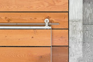 Architect Michael Cobb used Douglas fir harvested from the site throughout the house, such as on a sliding door outfitted with Swiss Rod SS hardware from the Real Carriage Door Company.</p><p><br>