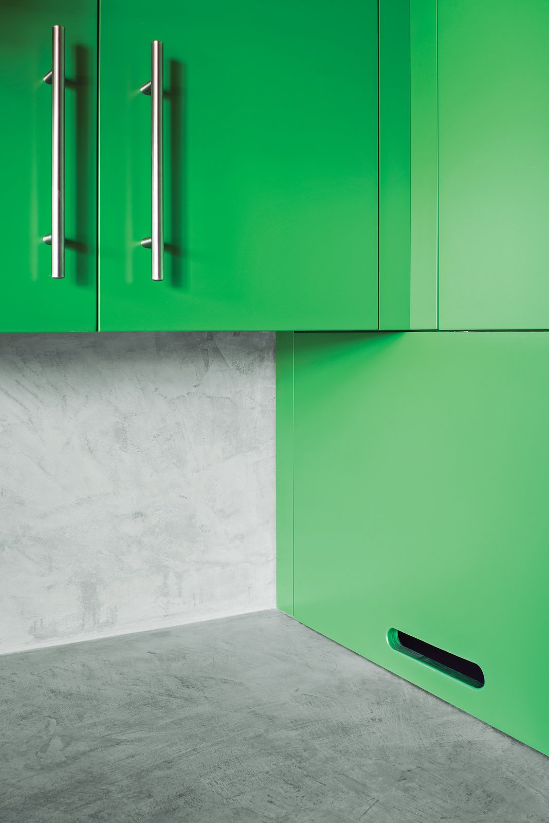 Kitchen, Colorful Cabinet, and Concrete Backsplashe In the kitchen, Santa Rosa-based Reliance Fine Finishing applied a conversion varnish tinted with a green hue.  Photo 4 of 5 in Yes, It Is Easy Being Green