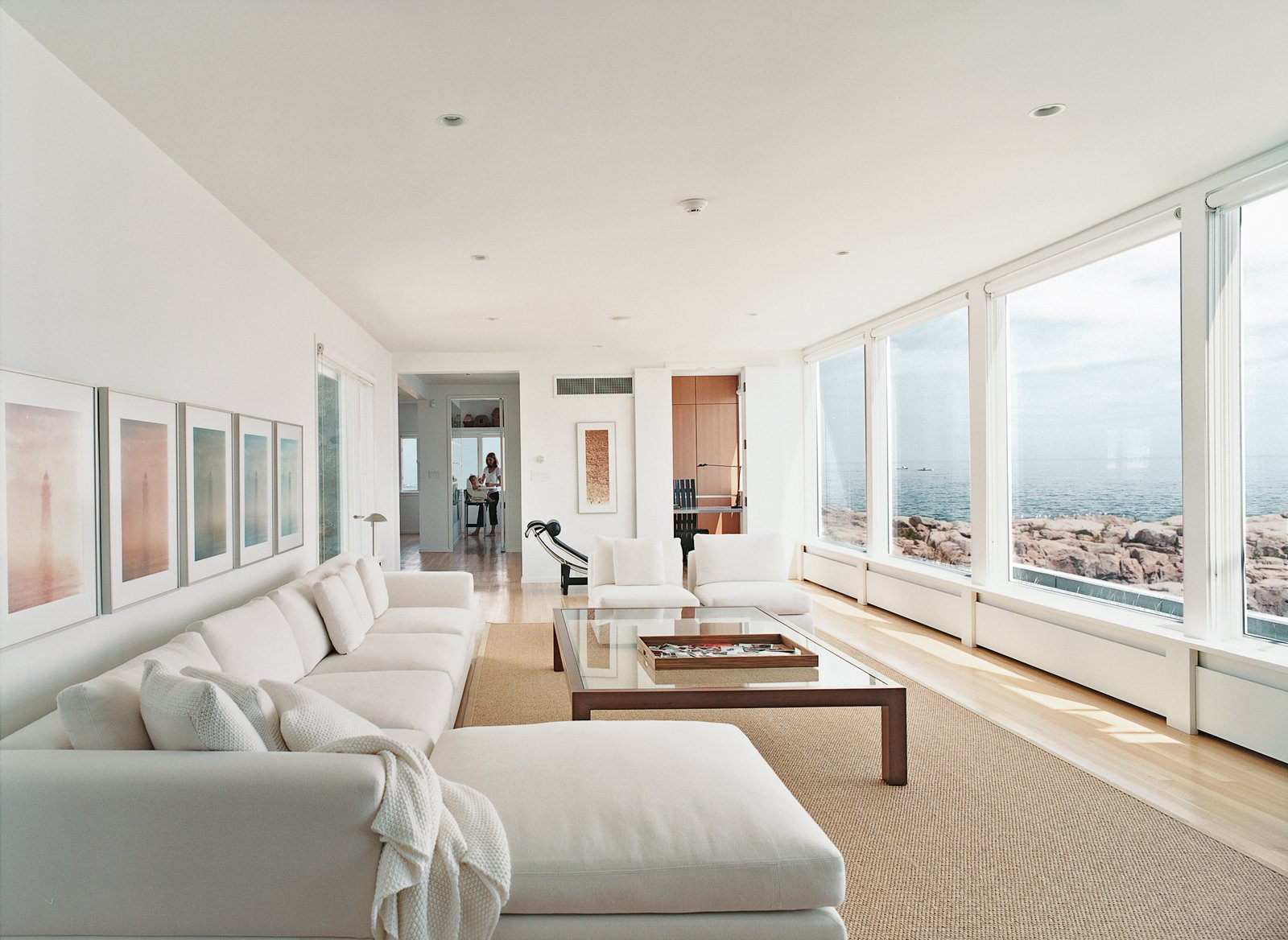 Living Room, Light Hardwood Floor, Recessed Lighting, and Sectional In the living room, there's a black leather Le Corbusier lounge and a Minotti sofa set.  Photo 3 of 9 in Bauhaus by the Sea
