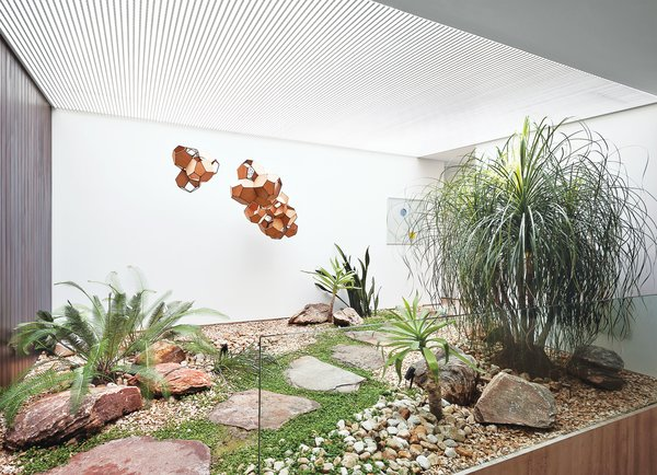 A small interior courtyard features a huge skylight and the sculpture Air-Port-City/Cloud-City/ 14-5-4 Cloud Modules 30 Net by Tomás Saraceno. Tagged: Living Room.  Photo 8 of 9 in Blockbuster Movies Can't Compete with These Monumental Views