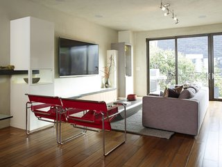 No Walls Were Knocked Down in the Making of This SF Pad - Photo 1 of 7 - The living room is furnished with Wassily chairs by Marcel Breuer, a Limbo coffee table from Roche Bobois, and a Reid sofa from Design Within Reach.