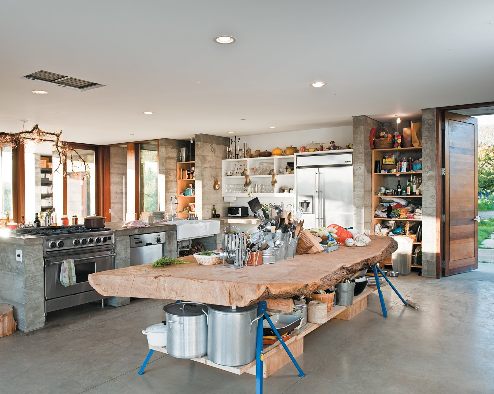 Kitchen and Wood Counter A massive slab of cypress perched atop sawhorses provides storage for pots and utensils.  Photo 5 of 18 in A Sonoma Prefab That Celebrates a Family's Passion for Cooking