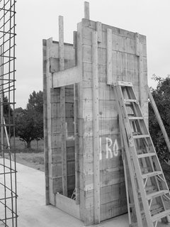 The Andersons designed a system of four-by-four-foot concrete modules, created from a reusable formwork of 2-by-12-foot boards that could be easily moved around the site. By using the units repeatedly, the architects saved on cost and materials as well as scaling the work to be manageable with one concrete truck and a two-person crew. The resulting facades are textured from the rough wooden planks.
