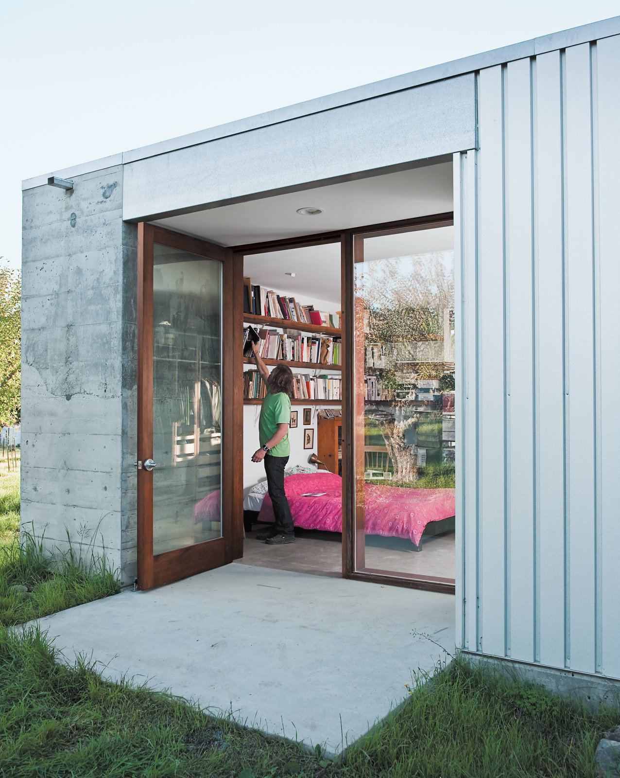 In the master bedroom, more shelves were installed to accommodate the book collection.  Photo 9 of 18 in A Sonoma Prefab That Celebrates a Family's Passion for Cooking