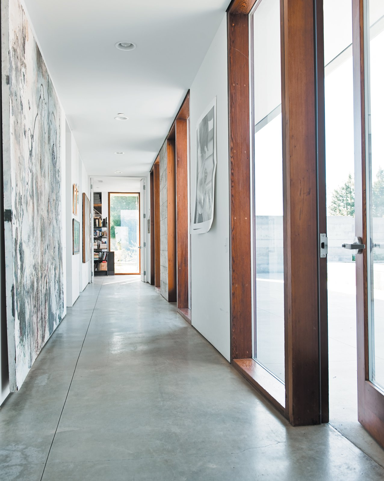 The long hallway leading to the bedrooms gets spectacular afternoon sun, lighting up the family's many works of art.  Photo 10 of 18 in A Sonoma Prefab That Celebrates a Family's Passion for Cooking