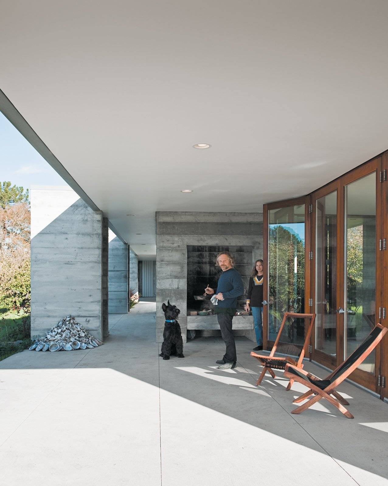 Ben enjoys spending time outdoors while preparing meals for his family. The outdoor hearth is primed all summer long.  Photo 15 of 18 in A Sonoma Prefab That Celebrates a Family's Passion for Cooking