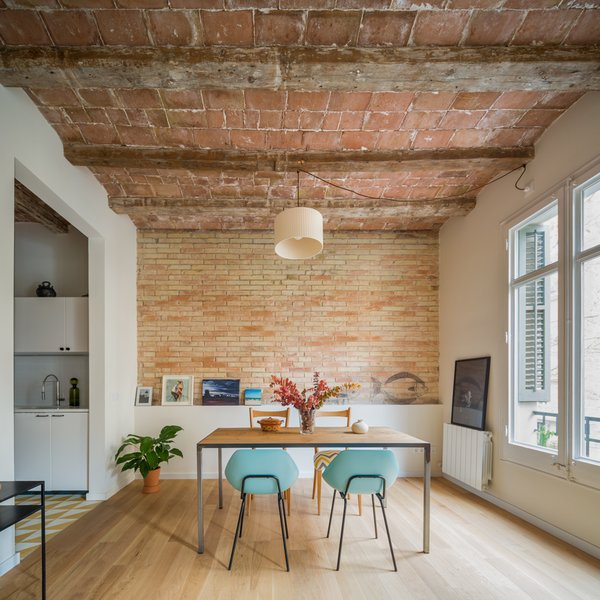 Nook Architects renovated an apartment in a 1931 building in Barcelona's Eixample district for a young woman who travels often for business.