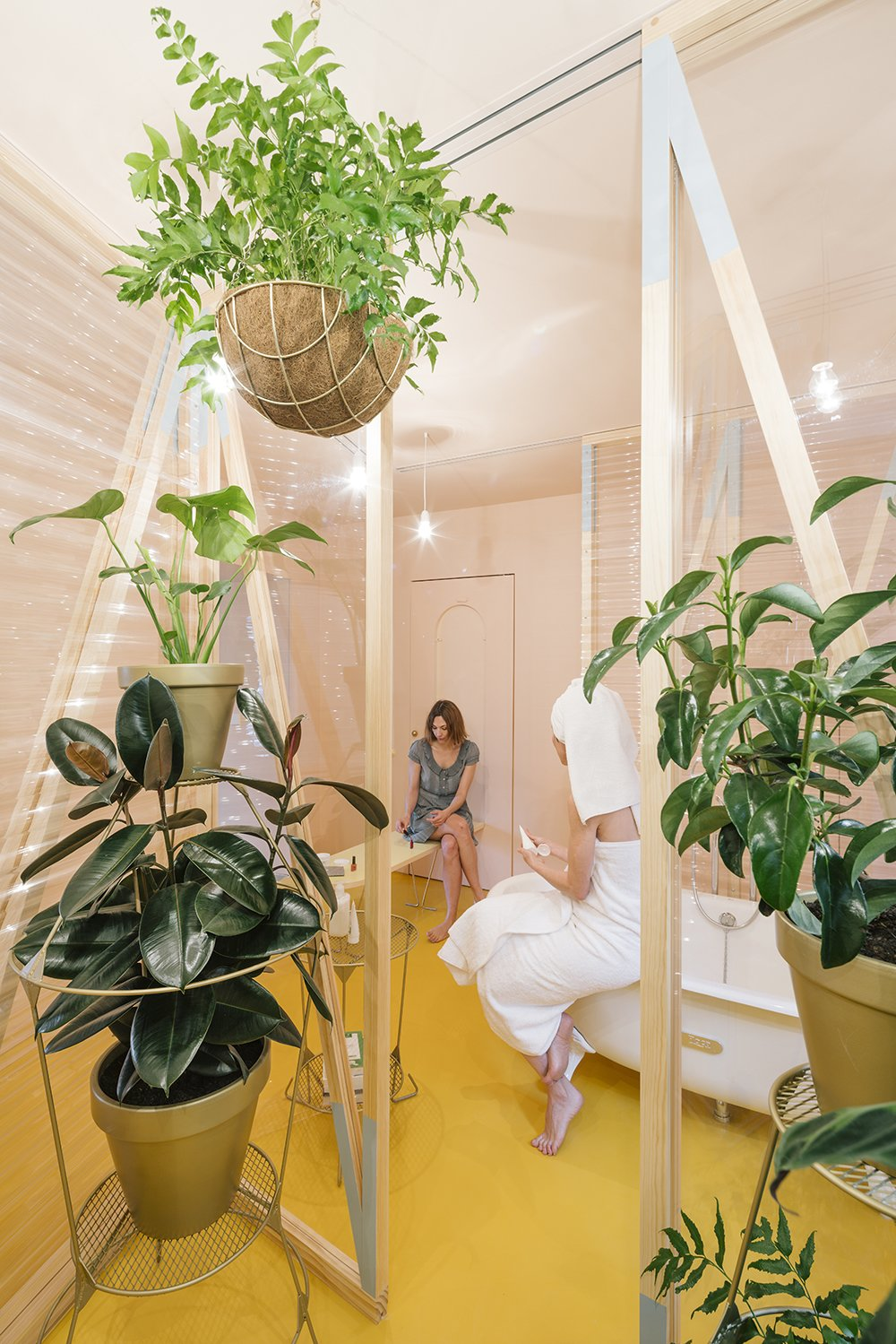 A canary yellow–floored bathroom with corrugated plastic walls is the centerpiece of the renovation.  Photo 2 of 7 in A Quirky Renovation Brings an Indoor Garden to the Center of Madrid