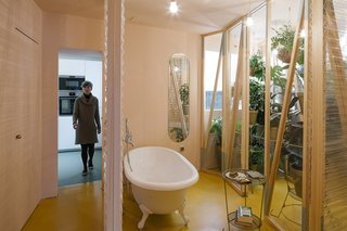 The bathroom is located at the heart of the apartment, with sliding plastic doors of varying transparency that can be moved into a number configurations.