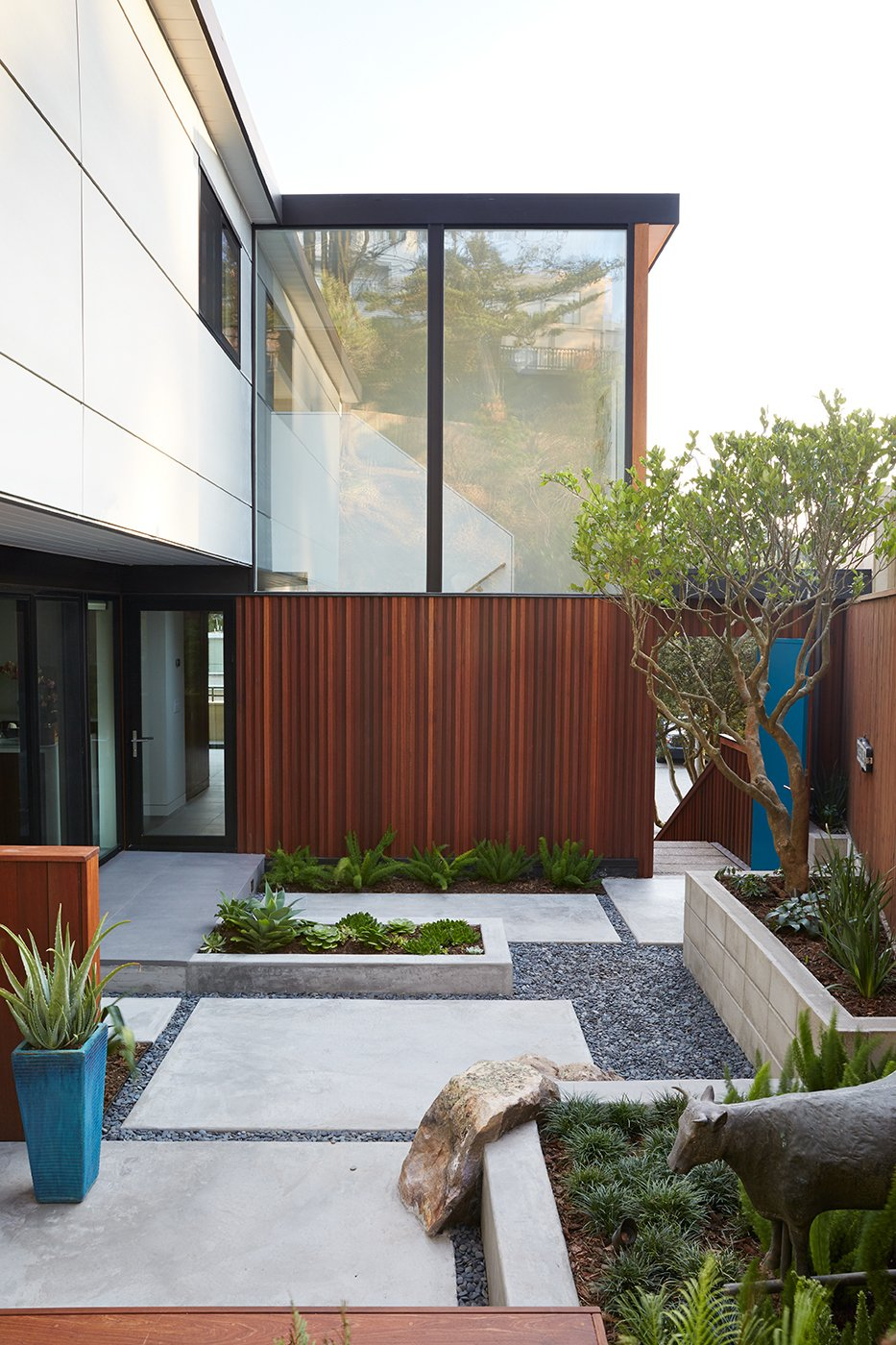 Outdoor, Small Patio, Porch, Deck, Pavers Patio, Porch, Deck, and Back Yard Outer Space Landscape Architects refreshed the courtyard with new hardscaping.  Photo 7 of 8 in Not the Eichler Post-and-Beam Style You Know
