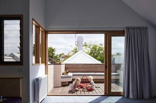 A small roof terrace offers a second outdoor enclave for play.