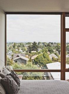 The third-floor master bedroom boasts sweeping views of Seattle.