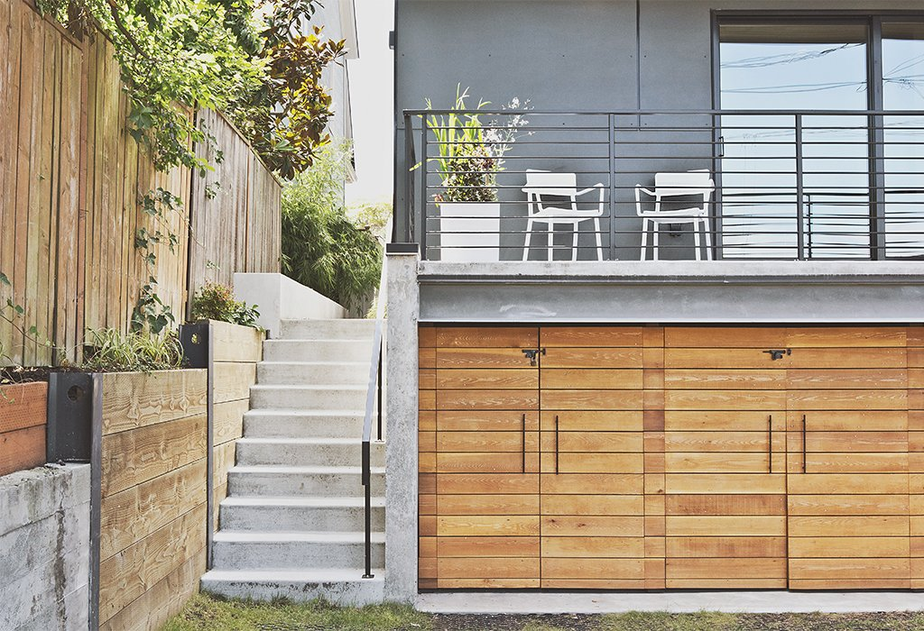 Pricier materials, like the locally sourced cedar used for the garage doors, are applied judiciously.  Photo 11 of 12 in Three Families Comfortably Fit in One Slim Lot
