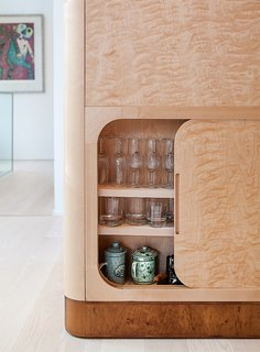 Salminen chose flame birch for the cabinetry for its remarkable wavy wood grain.