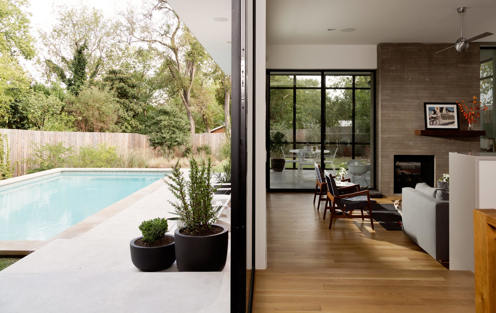 Outdoor, Large Pools, Tubs, Shower, Concrete Pools, Tubs, Shower, and Swimming Pools, Tubs, Shower A double-sided fireplace serves as a way to unite the screened-in porch to the house's main, open-plan living area.  Photo 4 of 6 in Refreshed Take on the Gable Shines in Austin's Building Boom