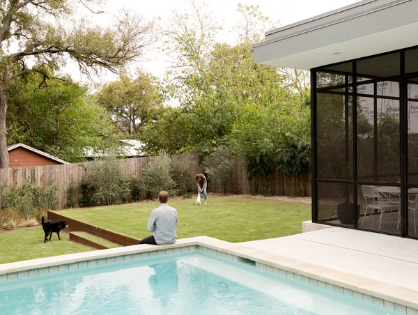 """Baldridge wanted the porch to feel like another room. """"When you try to make screened porches look like they're outside, [I think] they look terrible, so we chose to make it actually be a part of the house,"""" he says.  Photo 6 of 6 in Refreshed Take on the Gable Shines in Austin's Building Boom"""