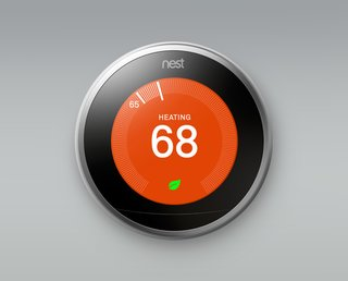 These Modern Parents Show How Invaluable Technology Can Be - Photo 7 of 12 - To make sure the home is always at a comfortable temperature—while saving energy wherever possible—they installed the Nest Learning Thermostat, which is also available through SAGE. By learning your desired temperature settings, it creates a custom schedule for your home. It also automatically turns itself down when you leave the house and can be controlled by your phone, television, tablet, or computer.