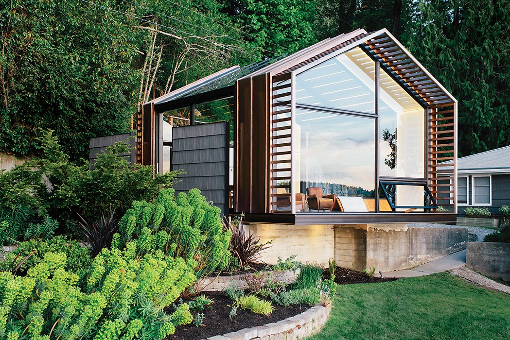 Exterior, Wood Siding Material, and House Building Type On Vashon Island, about 20 miles southwest of Seattle, architect Seth Grizzle designed a 440-square-foot multiuse structure for his clients Bill and Ruth True.  Photo 2 of 10 in A Former Garage Hosts the Best Parties