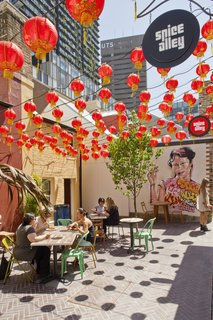 """9 Inspirational Examples of Adaptive Reuse - Photo 6 of 9 - Spice Alley's four outdoor eateries enliven the laneway under a canopy of red lanterns. """"Resurrected building frontages spill out onto the street and provide a streetscape that is activated by day and night by conversation, creative hustle, and culture,"""" says landscape architect Mike Horne of Turf Design Studio."""