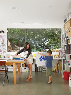 Verda Alexander and her son, Apolo, collaborate on a project in their first-floor studio.