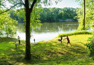 Three Joined Cabins Turn This Virginia Retreat Into a Modern Take on Camp - Photo 1 of 8 - Sited on a long and narrow 40-acre plot, the home opens to expansive views of the river, to the north—and plenty of space for the kids to play.