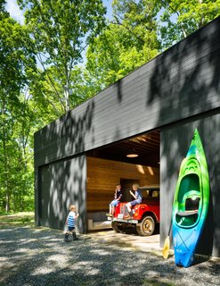 Three Joined Cabins Turn This Virginia Retreat Into a Modern Take on Camp - Photo 3 of 8 - The spacious detached garage stows a bevy of kayaks and inner tubes, not to mention the family car.