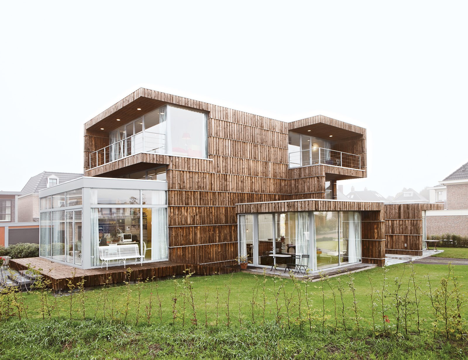 Exterior, Flat RoofLine, Green Roof Material, Green Siding Material, and House Building Type Villa Welpeloo in Enschede, the Netherlands, doesn't look like a recycled building, but Jan Jongert and Jeroen Bergsma of 2012Architects began the design process by first scouting the local area for items to recycle. The  Photo 1 of 14 in This Home Takes Recycling to the Next Level