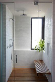 A Clean And Simple Shower In Chicago Is Lined With Modern Subway Tiles And  A Wood