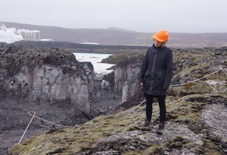 "Architect Sigríður Sigþórsdóttir of BASALT Architects surveys the environment. ""She knows every inch of this land,"" says Sigurdur Thorsteinsson of Design Group Italia, who has worked with the architect on the site for the past 20 years."